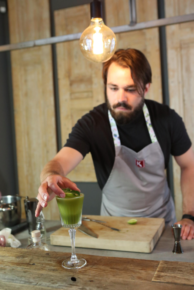 Stijn is putting the finishing touches on the Matcha Gimlet