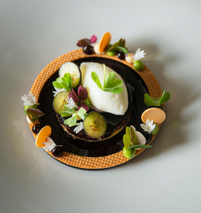Chocolate, ginger ice cream & olive crunch, Limon Cress and Cardamom Leaves