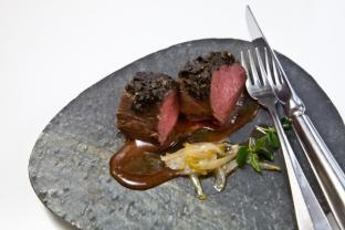 Silver-side New Zealand venison covered with black olive crust, garlic