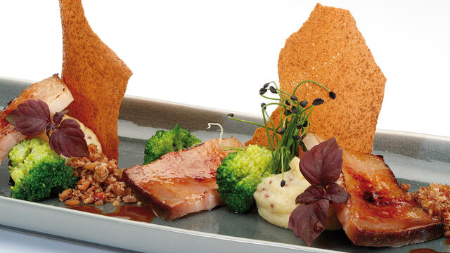 Caramelized Livar pork belly with Limburg mustard and Frisian rye bread