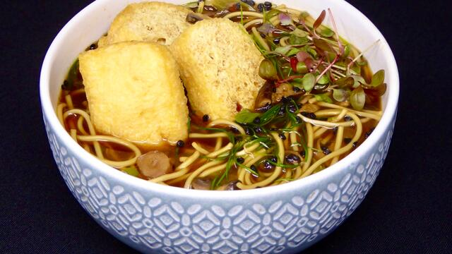 Egg noodle soup with bean curd and mushrooms