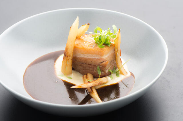 Sour meat from pork belly with cream of parsley root