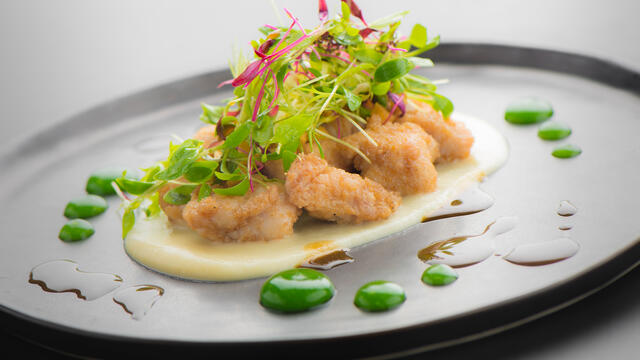 Lamb sweetbreads with cinnamon flowers, celery cream, honey salad and wheatgrass