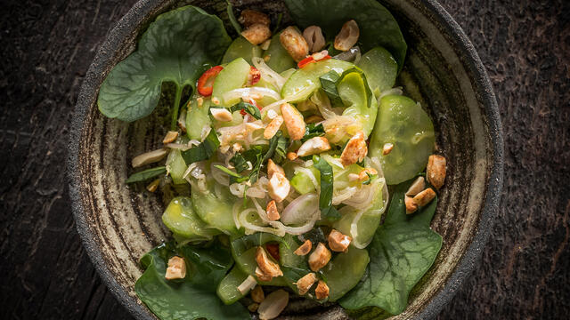 Cucumber salad with Thai basil, shallot, lime, red allspice, roasted peanuts and Syrha Leaves