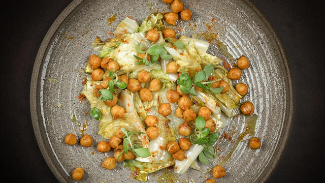 Roasted chickpea chermula with endive, lemon and Gangnam Tops