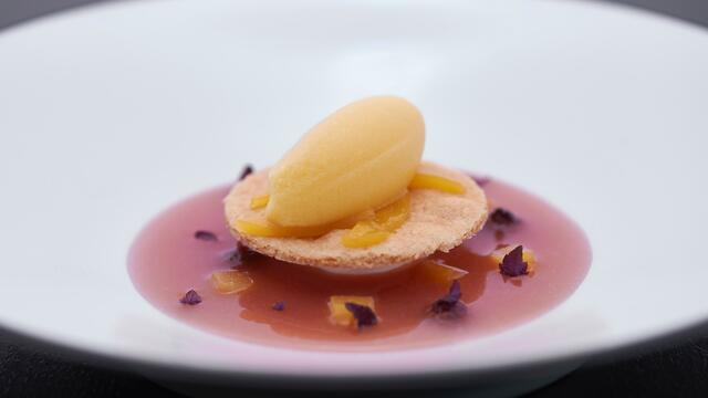 Hand-beaten mascarpone, yellow peach with Shiso and hazelnut sable