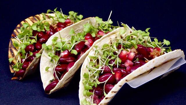 Chili con carne and pomegranate tacos
