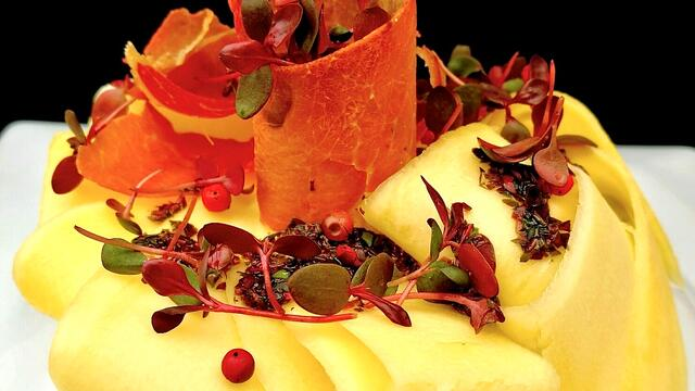 Mango Carpaccio and Parma ham with pink peppercorn dressing