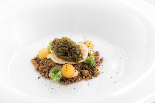 Buckwheat blini with caviar, apple and BlinQ Blossom